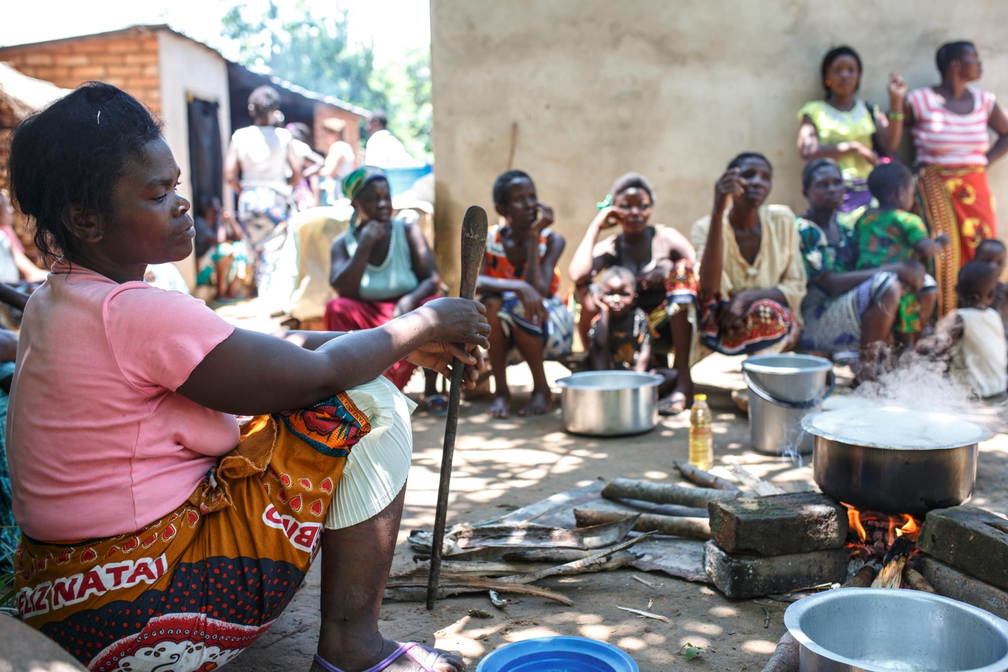 Women in Pitala, a small village near Lake Malawi in the north of the country, cooking over an open 'three-stone' fire